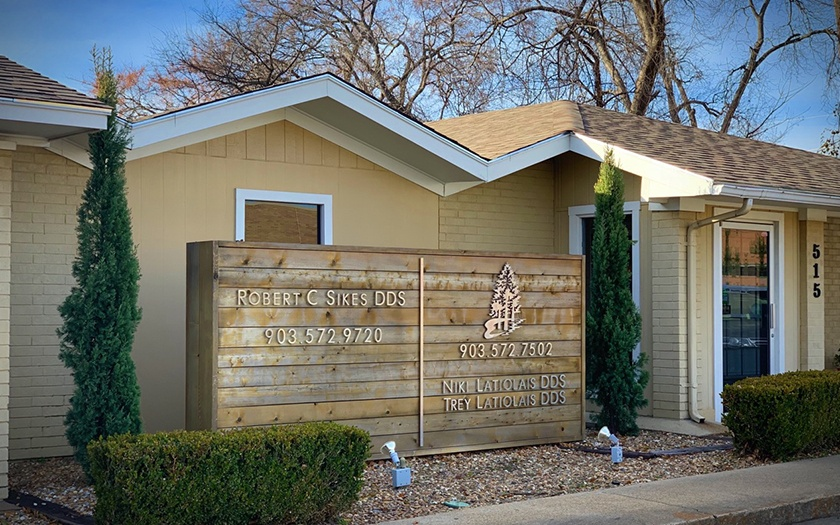sign and trees outside office