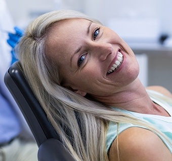 woman in exam chair smiling