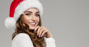 Woman in a Santa hat smiling