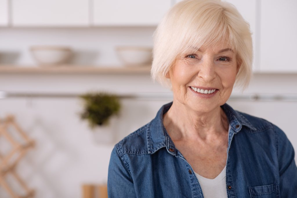 older woman smiling blonde hair