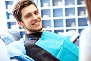 man in dentist chair smiling